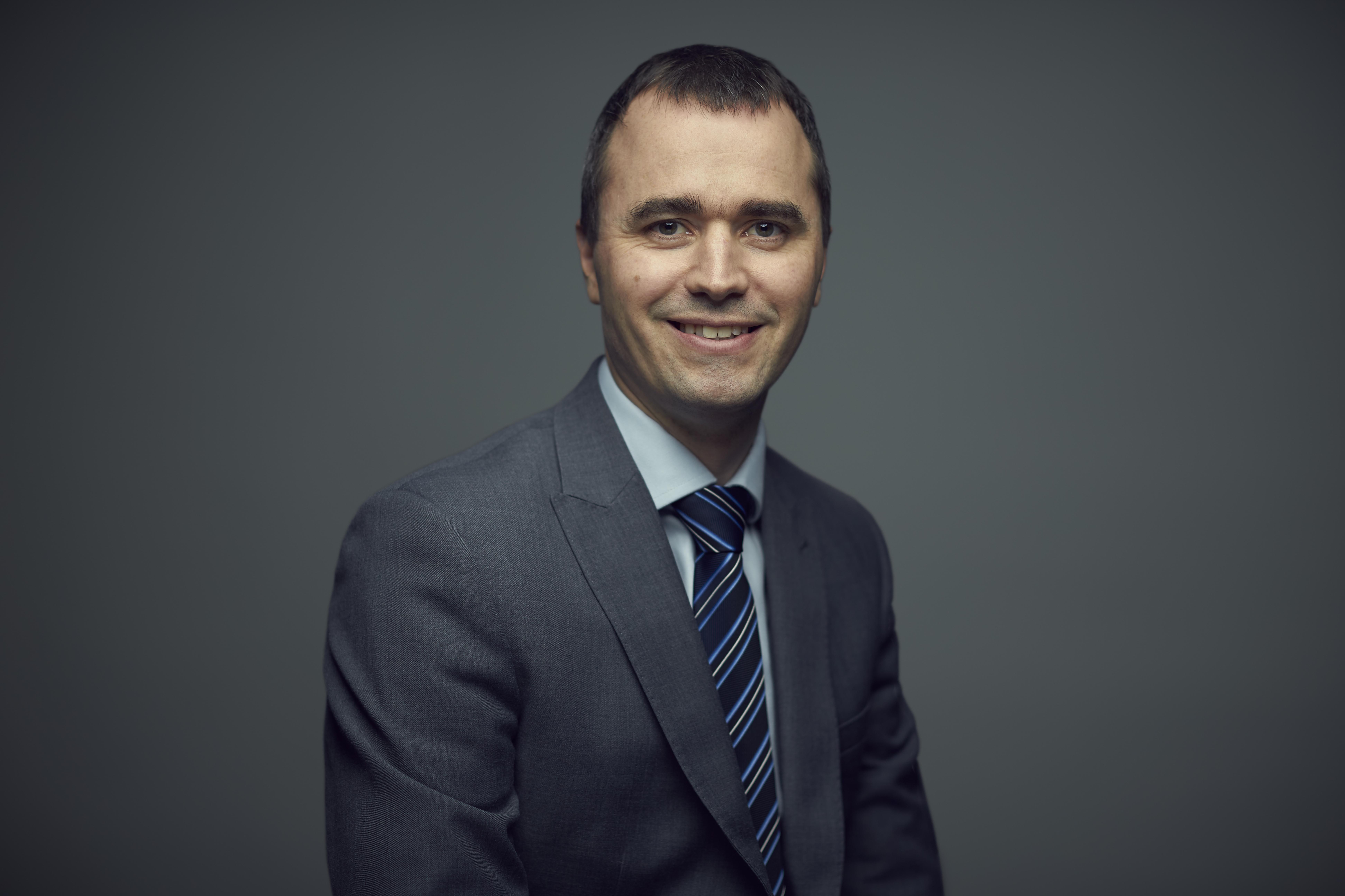 Dr Andrew. J. Tatham